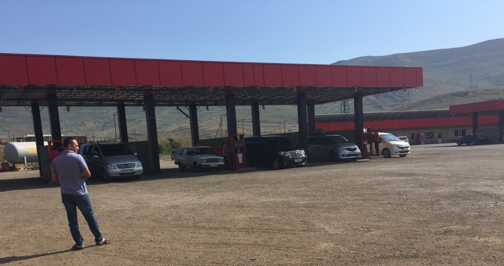 Refilling station with cars.